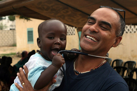 US naval officer holds a Senegalese baby. Part of a medical outreach project.