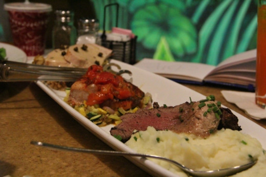 """Garden Grill is served """"family style,"""" with large platters of food for the whole table."""