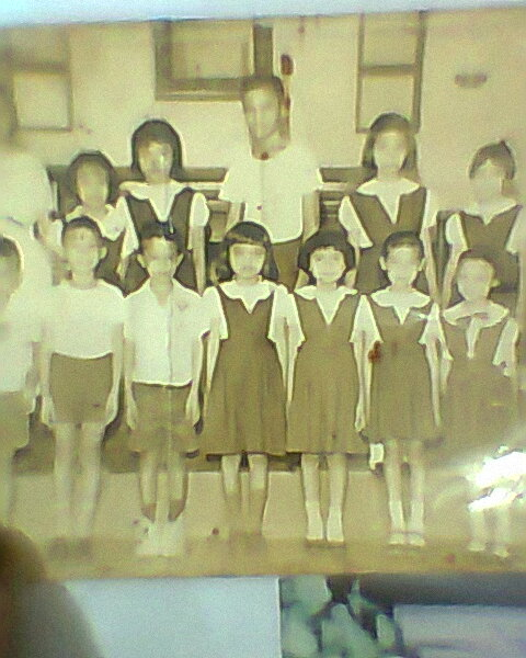 I am the tallest girl, middle front; this is a Seventh Day Adventist Church School. I am 7 years old in this picture.