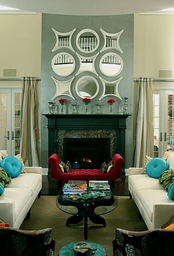 A grouping of small mirrors above a fireplace makes the same impact as one large mirror.