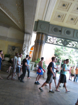 A guy (center) wearing a Spiderman Tutu, walking with a bunch of guys in front of Bellagio hotel. HAD to be a bachelor party!