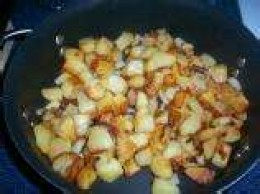 Fried potatoes and onions -- personally, I prefer to cook this dish a little browner than shown here. Also, potatoes are diced in the photo -- your choice -- diced or french fry style.