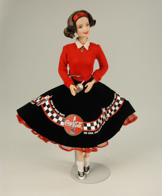Coca Cola Barbie Doll in black and red skirt reminiscent of pool skirts