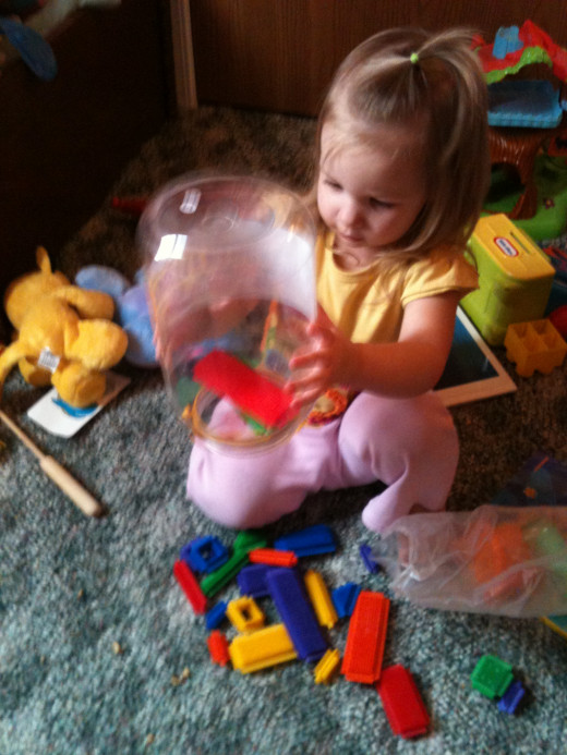 Chloe playing with her thistle blocks!!