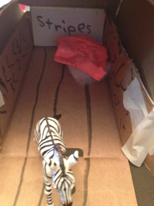 Creative thinking: How to design a stable for a Zebra: Named stripes, stripes on the floor, and horizontal walls to pull it all together.