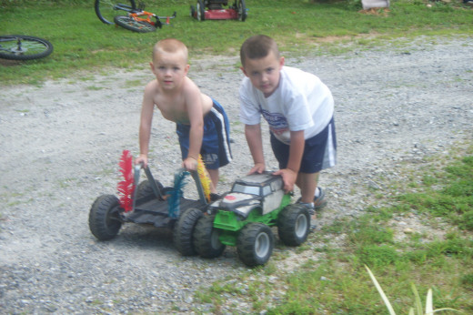 My grandsons Colton and Maddox with Black Jack and Gravedigger having a back yard Monster Jam.