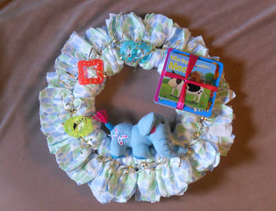A diaper wreath is a great alternative to the more common diaper cake and anything involving baby gifts is a wonderful choice when you're looking for craft ideas to sell.