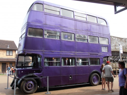 The Knight Bus in the back lot. Privet Drive and the covered bridge at Hogwarts can be seen in the background