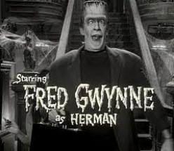 Isn't Romney on stage identical to Herman Munster?