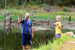 """""""Papa"""" Johnny showing off Ethan's catch of the day."""
