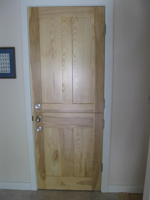 Interior door made of white ash.  This particular door, leading to the basement, was split to make a Dutch door.