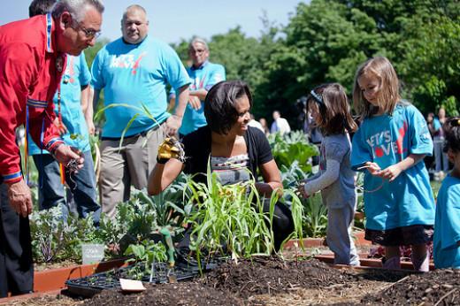 First Lady Michelle Obama with schoolchildren in the White House kitchen garden.