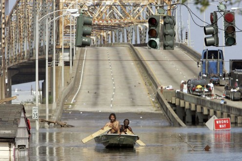 Rowing to safety during Hurricane Katrina. Sad images like this just show how bad this disaster actually was.