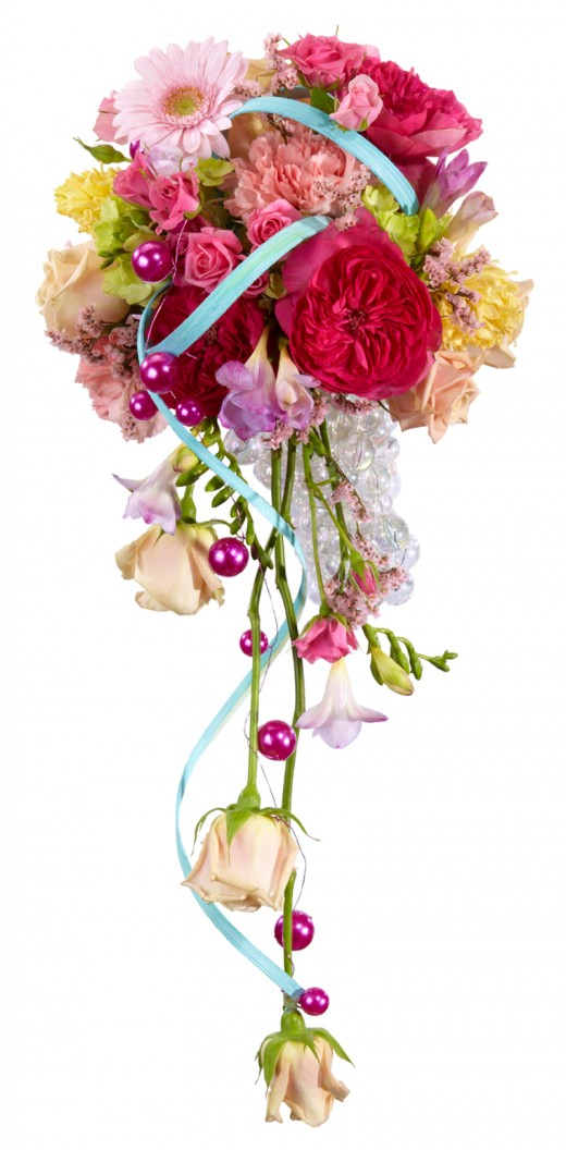 A beautiful modern bouquet of mixed flowers in an oasis bouquet holder embellished with wire.