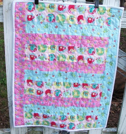 A picket fence is always a fantastic choice for hanging a quilt.