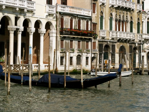 A gondola docked between traditional posts.