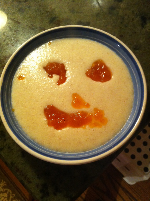 Still my idea of a good birthday dinner:  cream of wheat decorated with an apricot jelly face.
