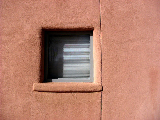 An example of an exterior cement stucco that is painted to look like traditional adobe