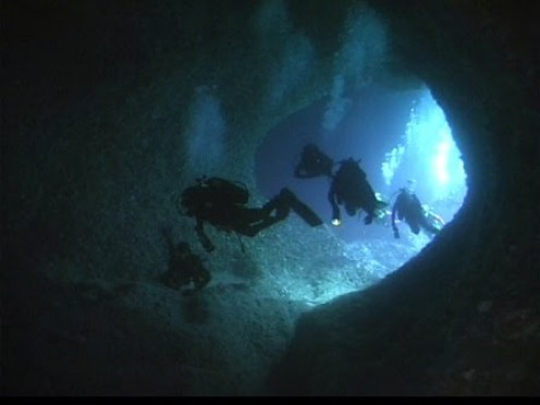 Underwater caves found while scuba diving.  Before you go cave diving you must be certified to do so.