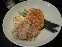 My husband's grilled Norwegian Salmon served with rice on a bed of asparagus was a hit!