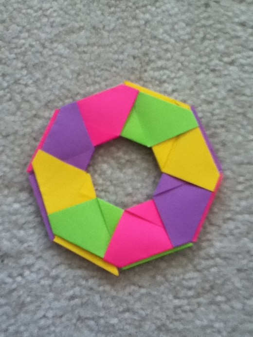 This is yyour circular part of the ninja star. If you push the sides inward you will have the picture below.