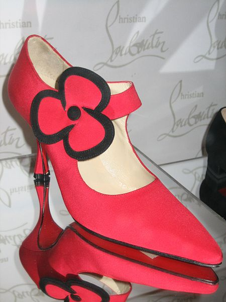 This shoe designed by Christian Louboutin was photographed at the Bata Shoe Museum by Sheila Thompson on February 28, 2006. Red soles are a trademark of Louboutin's shoe designs.