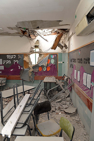 Destruction of an Israeli kindergarten by a rocket fired from Gaza.