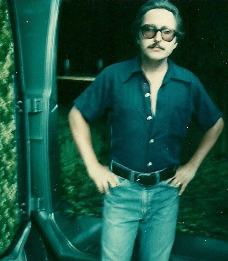 Me in 1979 after I had customized my new van with a table, refrigerator, bench seating and shag carpeting. Oh...and the ceiling mounted 8 track tape system.