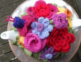 Crochet flowers used to make a tea cozy.