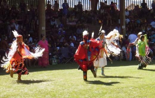 Young women dancing traditional dances in Kamloops heat at Kamloopa Powwow 2012.