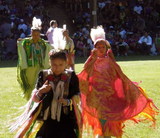 After the dance, young women dancers leave the field.