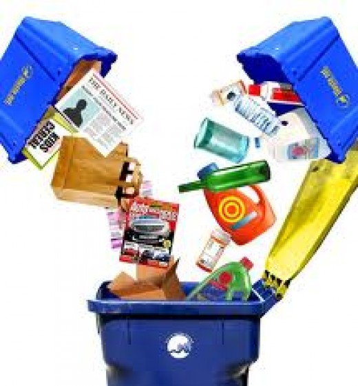 The blue recycling bin where newspapers and other recyclable items go.
