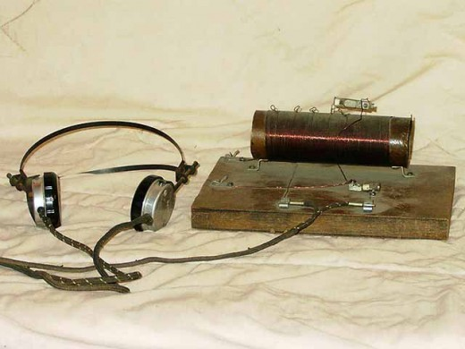This is a simple crystal radio. It requires no battery or any power source for that matter.