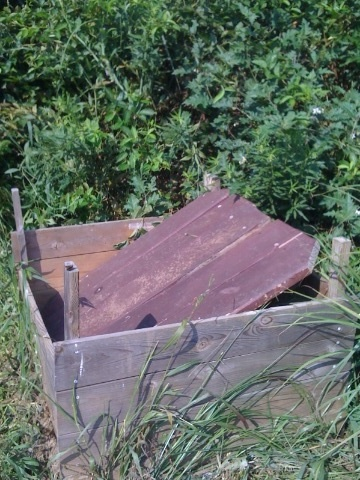 I use an old picnic table top as a lid for my composter.