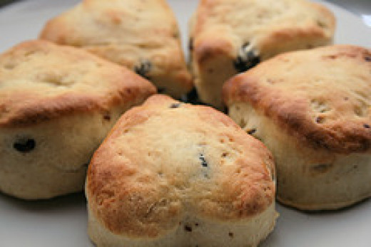 "The word scone may derive from the Gaelic term ""sgonn"" meaning a shapeless mass or large mouthful."