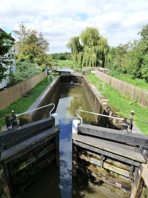 Photo of a canal lock taken from a footbridge