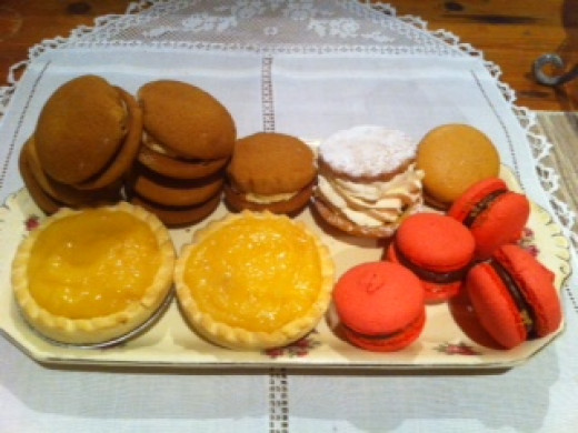 Macaroons, Ginger Kisses, Lemon Tarts,Cream Cakes.