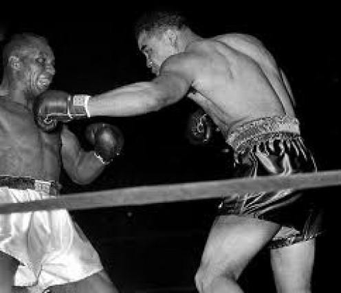 Joe Louis snapping a hard jab into Jersey Joe Walcott's Face. The two fought twice with Louis winning by disputed decision and by knockout in the second bout.