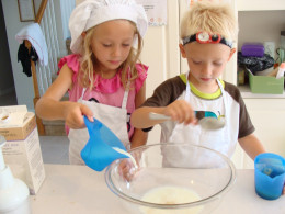 Alex and Grace combine the wet ingredients first.