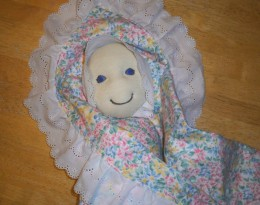The triangular blanket is perfect for teaching little ones how to swaddle a baby.