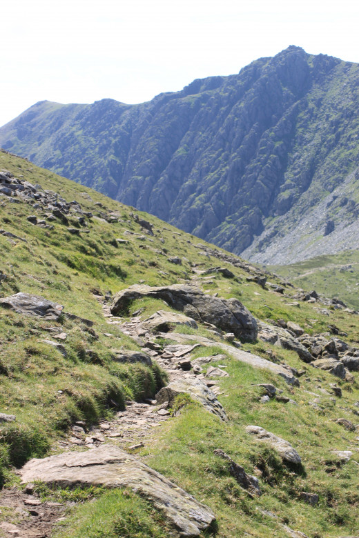 The path tipping down towards Goat Hawse Pass with the rugged Dow Crag face ahead