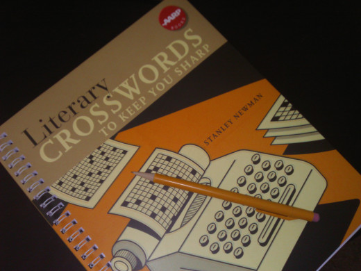 A crossword puzzle book and pencil