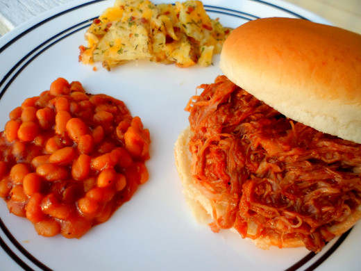 Our finished pulled pork sandwiches served with baked beans and cheesy potatoes.