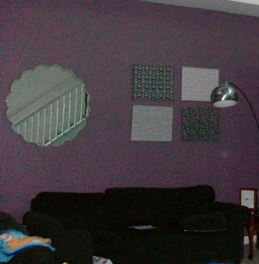 In this picture, the homeowner painted a single wall in a soothing black raspberry tone.