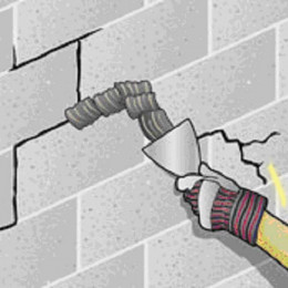 Fig 1.  Patching up a leaky wall with waterproof mortar.