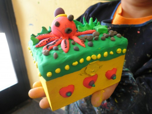 A cute little treasure box painted first, then overlaid with Cloud Clay. This one had an underwater theme.