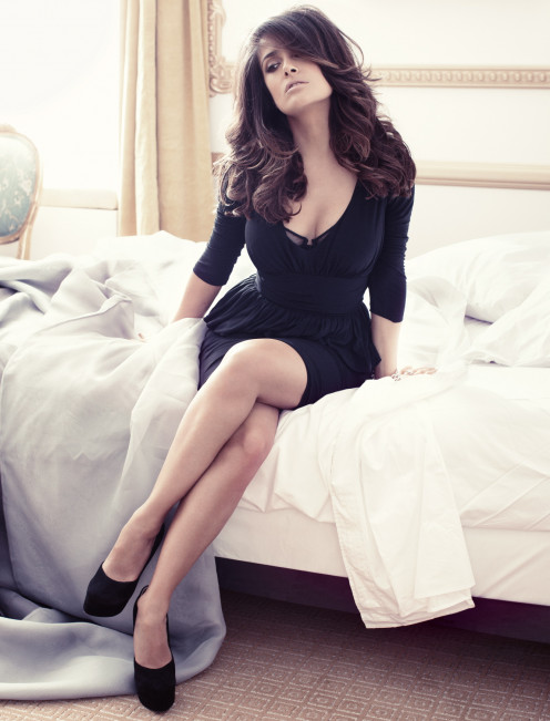 Gorgeous Salma Hayek posing in a low cut black dress and high heels
