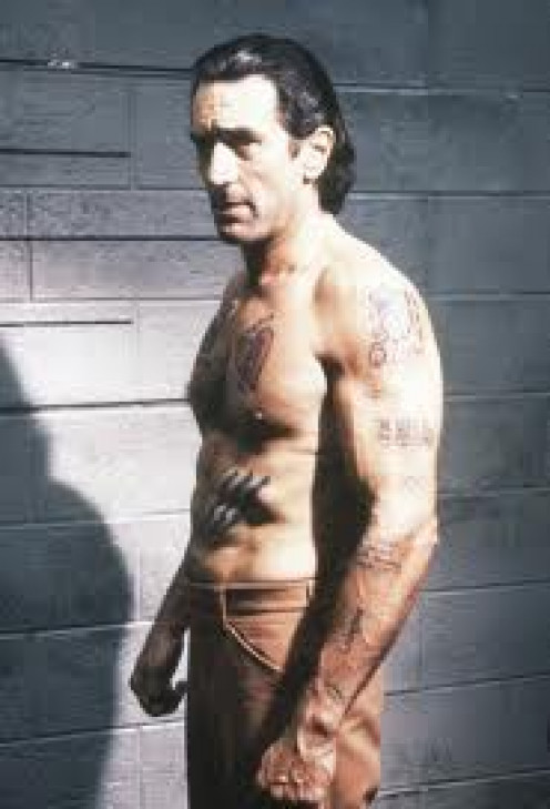 Robert De Niro in Cape Fear. This is one of De Niro's top performances. He plays as a country red neck, need I say more.