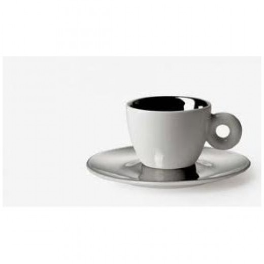 "The artist, Anish Kapoor, designed a cup and saucer set which has a platinum saucer with a hole in the centre that sits on top of the cup. As described in illy website literature, ""the flickering reflections become form and touch on themes such as do"