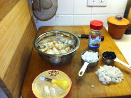Bread cubes, garlic, onions, feta cheese, black olives, and Greek seasoning